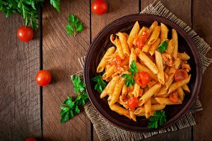 penne-pasta-tomato-sauce-with-chicken-tomatoes-wooden-table